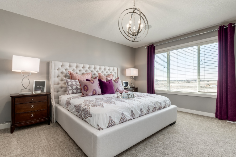 Sterling Homes master bedroom with king size bed and bright window